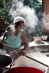 Luciana B. Vasconcelos, 58, works with the family in one of the last houses of flour in Sap&ecirc; From The North, as this Afro-Descendant place is called.<br /> Afro-Descendant Community Angelim I Ita&uacute;nas town, Esp&iacute;rito Santo State - Brazil.<br /> <br /> Luciana B. Vasconcelos, 58 anos,  trabalha com a fam&iacute;lia em uma das &uacute;ltimas casas de farinha do Sap&ecirc; do Norte, como &eacute; chamado esse lugar de quilombos.<br /> Comunidade Quilombola Angelim I, Ita&uacute;nas, Esp&iacute;rito Santo - Brasil.