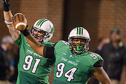 Oct 9, 2015; Huntington, WV, USA; Marshall Thundering Herd defensive lineman Jarquez Samuel (94) celebrates a touchdown after an interception during the third quarter against the Southern Miss Golden Eagles at Joan C. Edwards Stadium. Mandatory Credit: Ben Queen-USA TODAY Sports