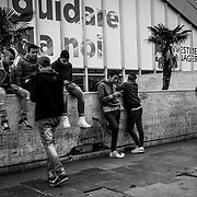 Rome, at the entrance of Termini Train Station, boys , including many minors mostly Egyptians, North Africansmeet themselves daily, near a low wall.