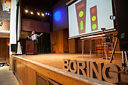 The Boring Conference at Conway Hall. James Ward, organiser of the conference speaking about &quot; Pedestrian Crossing Signals used in the German Democratic Republic 1961-1990&quot;. The Boring Conference is a one-day celebration of the mundane, the ordinary, the obvious and the overlooked; subjects often considered trivial and pointless, but when examined more closely reveal themselves to be deeply fascinating.<br /> <br /> It was created in response to the cancellation of the 2010 Interesting Conference. It seemed like the obvious thing to do.