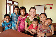 Maggie Doyne and her children. Kopila Valley Children's Home, Surket, Nepal