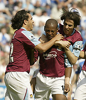 Photo: Aidan Ellis.<br /> Wigan Athletic v West Ham United. The Barclays Premiership. 28/04/2007.<br /> Carlos Tevez (L) and Youssi Benayoun (R) celebrate with fist goal scorer Luis Boa Morte