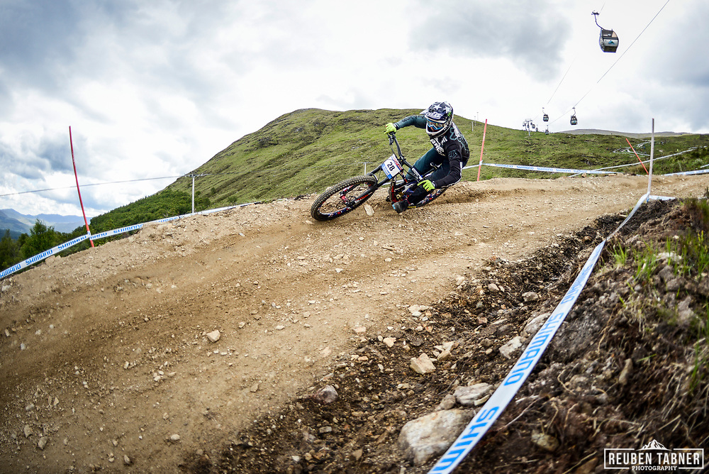 Charlie Harrison of Intense Factory Racing rides the rails of the Fort William downhill track during practise at the UCI Mountain Bike World Cup.