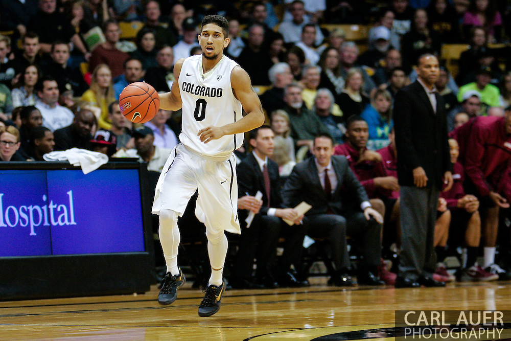 November 24th, 2013:  Colorado Buffaloes junior guard Askia Booker (0) brings the ball up court in the second half of the NCAA Basketball game between the Harvard Crimson and the University of Colorado Buffaloes at the Coors Events Center in Boulder, Colorado