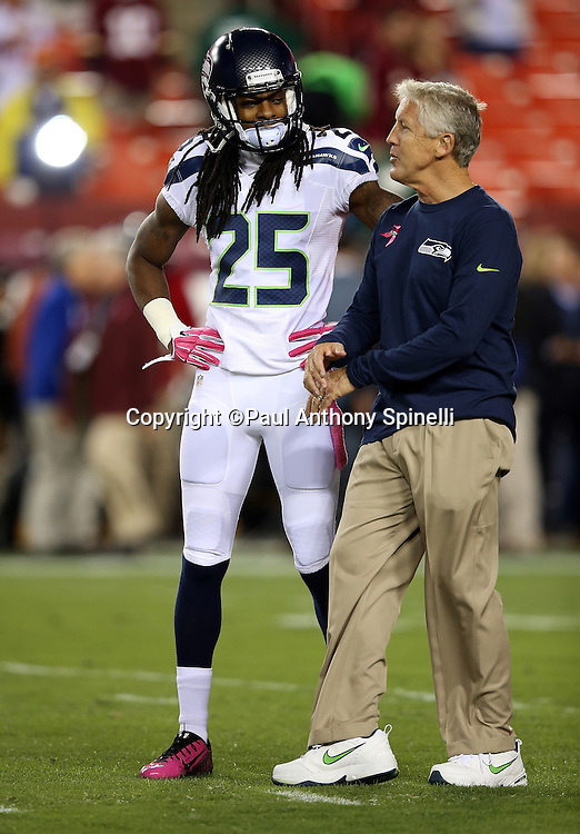 Seattle Seahawks cornerback Richard Sherman (25) talks to Seattle Seahawks head coach Pete Carroll before the NFL week 5 regular season football game against the Washington Redskins on Monday, Oct. 6, 2014 in Landover, Md. The Seahawks won the game 27-17. ©Paul Anthony Spinelli