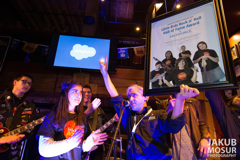 Salesforce employees and customers attend The Night Before Super Bowl 50 VIP Party featuring performances by Little Kids Rock and Paul McDonald at Pete's Tavern in San Francisco. (© Photo by Jakub Mosur)
