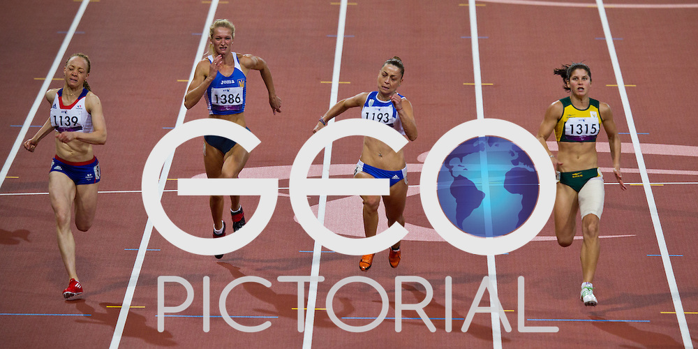 L-R: Nantenin Keita of France, Olena Gliebova of Ukraine, Alexandra DImoglou of Greece, Ilse Hayes of South Africa compete in the women's T13 100m final on day 8 of competition in the Olympic Stadium during the London 2012 Paralympic Games; 1st September 2012;