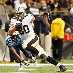 Aug 15, 2014; New Orleans, LA, USA; New Orleans Saints tight end Jimmy Graham (80) breaks away from Tennessee Titans defensive back Tommie Campbell (37) during second quarter of a preseason game at Mercedes-Benz Superdome. Mandatory Credit: Derick E. Hingle-USA TODAY Sports