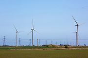 Little Cheyne Court Wind Farm just north of Camber Sands, Sussex, United Kingdom. The farm was built by npower Renewables and has supported 26 turbines since 2008, and cost £50 million to erect. In the distance, the pylons can be seen.<br /> (photo by Andrew Aitchison / In pictures via Getty Images)