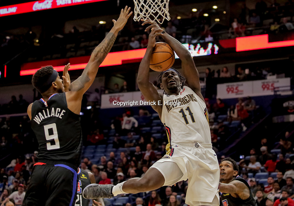 Dec 3, 2018; New Orleans, LA, USA; New Orleans Pelicans guard Jrue Holiday (11) loses the ball as he goes to the basket as LA Clippers guard Tyrone Wallace (9) defends during the second half at the Smoothie King Center. Mandatory Credit: Derick E. Hingle-USA TODAY Sports
