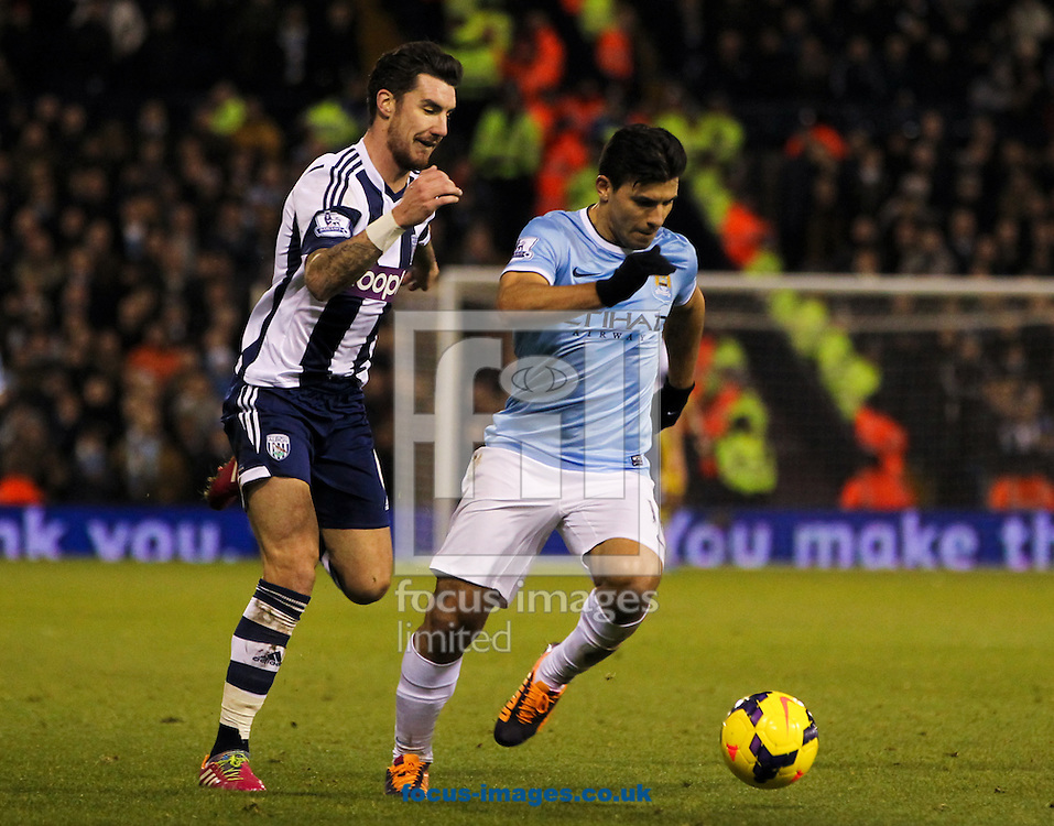 Picture by Tom Smith/Focus Images Ltd 07545141164<br /> 04/12/2013<br /> Liam Ridgewell (left) of West Bromwich Albion puts Sergio Ag&uuml;ero (right) of Manchester City under pressure during the Barclays Premier League match at The Hawthorns, West Bromwich.