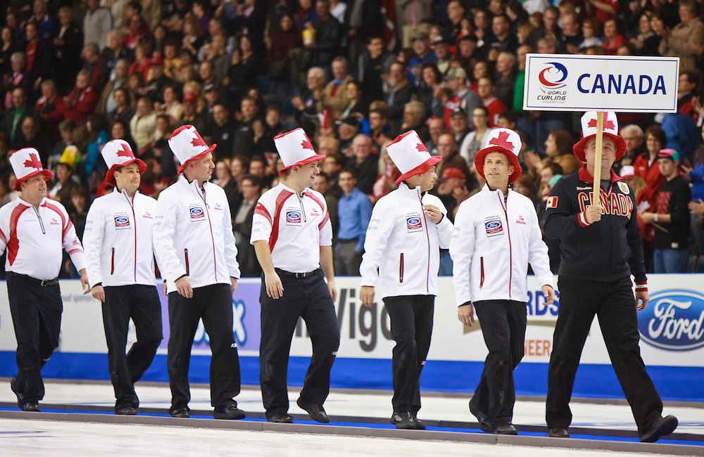 Canada's Skip Jeff Stoughton, 2nd right, and his teammates enter the rink with big canada hats for the evening draw at the Ford World Men's Curling Championships at the Brandt Centre in Regina, Saskatchewan, April 7, 2011.<br /> AFP PHOTO/Geoff Robins