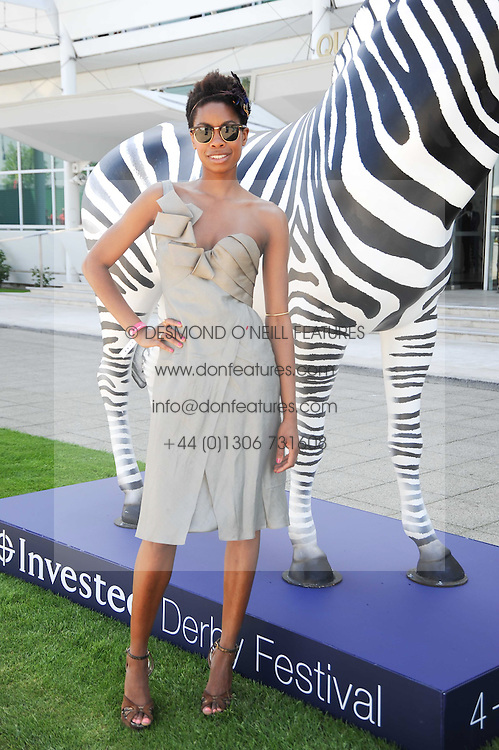TOLULA ADEYEMI at the Investec Ladies Day at Epsom Racecourse, Surrey on 4th June 2010.