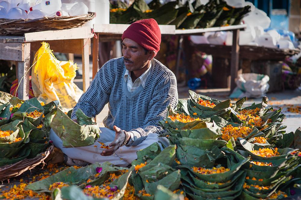 Flower seller at street stall (India)