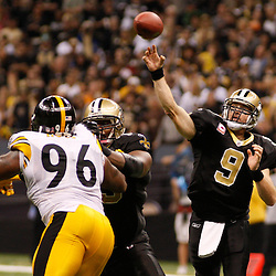 Oct 31, 2010; New Orleans, LA, USA; New Orleans Saints quarterback Drew Brees (9) throws a touchdown pass during the second half against the Pittsburgh Steelers at the Louisiana Superdome. The Saints defeated the Steelers 20-10.  Mandatory Credit: Derick E. Hingle..