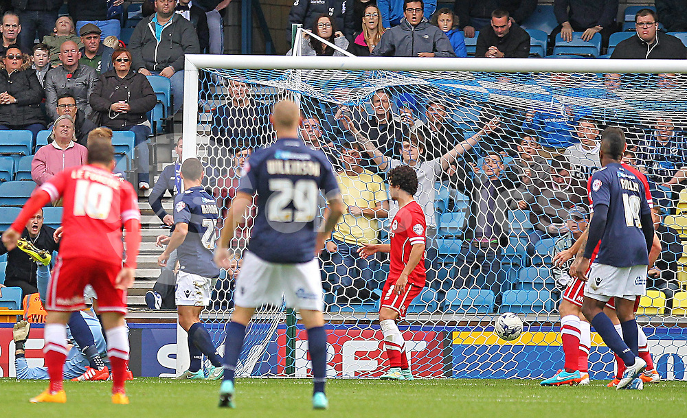Millwall Danny Shittu scores the opener during the Sky Bet Championship match between Millwall and Cardiff City at The Den, London, England on 25 October 2014. Photo by Phil Duncan.