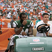New York Jets cornerback Darrelle Revis (24) leaves on a golf cart during the second half of an NFL football game against the Miami Dolphins at SunLife Stadium in Miami, Florida.  Revis has a torn anterior cruciate ligament in his left knee that will require surgery, likely meaning he'll miss the rest of the season, the team announced Monday, Sept. 24, 2012. (AP Photo/Alex Menendez)
