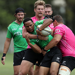 Coenie Oosthuizen of the Cell C Sharks and Robert du Preez of the Cell C Sharks tackle Danrich Visagie during the Cell C sharks training at Jonsson Kings Park ,Durban.South Africa. 08,10,2018 (Photo by Steve Haag)