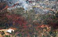 A stripe of fire retardant is seen from the air near Yarnell, Arizona separating a burned area from green July 1, 2013.  An elite squad of 19 Arizona firemen was  killed in the worst U.S. wildland firefighting tragedy in 80 years apparently outflanked and engulfed by wind-whipped flames in seconds, before some could scramble into cocoon-like personal shelters. REUTERS/Rick Wilking (UNITED STATES)