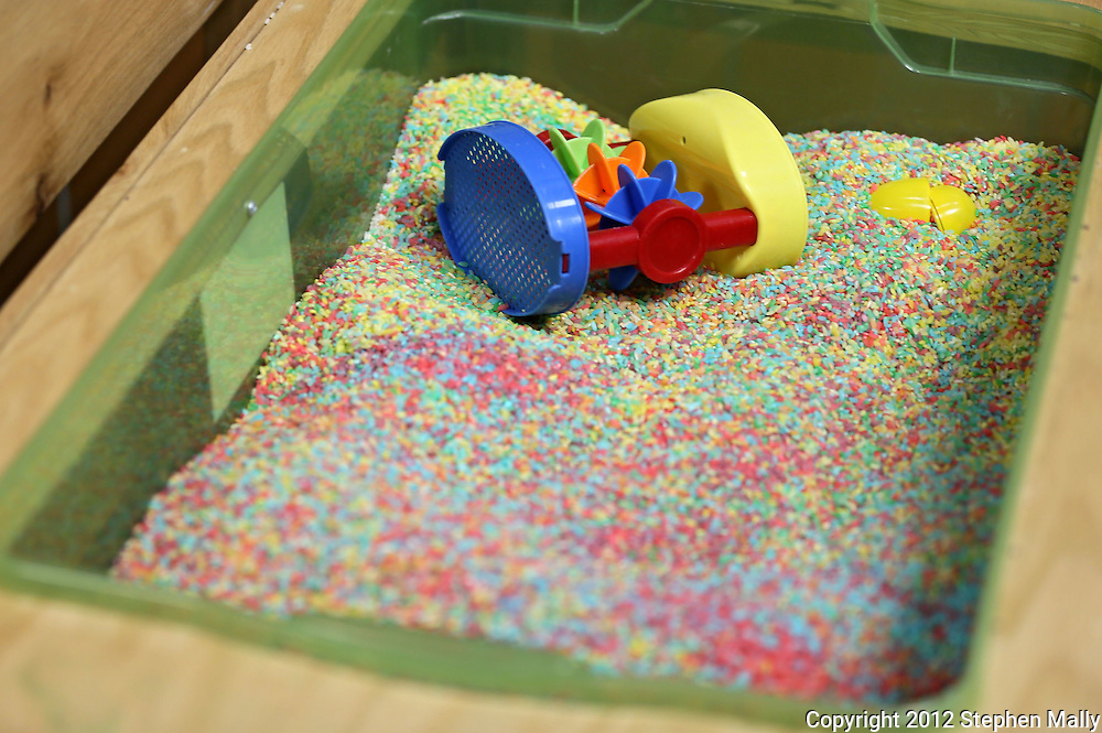 Colored rice in a sensory table at the Arc of East Central Iowa, 680 2nd St SE #200, in Cedar Rapids on Wednesday afternoon, May 16, 2012. (Stephen Mally/Freelance)