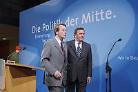 """13 MAY 2002, BERLIN/GERMANY:<br /> Franz Muentefering (L), SPD Generalsekretaer, und Gerhard Schroeder (R), SPD, Bundeskanzler, vor dem Schriftzug """"Die Politik der Mitte"""" nach der Pressekonferenz zur vorangegangenen SPD Parteikonferenz, Willi-Brandt-Haus<br /> IMAGE: 20020513-03-026<br /> KEYWORDS: Gerhard Schröder, Franz Müntefering"""