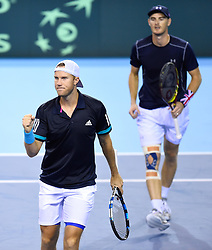 Great Britain's Dominic Inglot (left) celebrates after winning the second set during day two of the Davis Cup match at Emirates Arena, Glasgow.