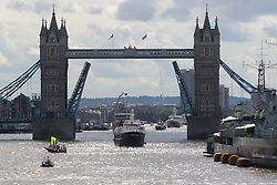 London Bridge, London, June 15th 2016. A flotilla of fishing boats led by UKIP's Nigel Farage heads through Tower Bridge in protest against the EU's Common Fisheries Policy and in support of Britain leaving the EU. PICTURED: The first of the big trawlers enters the Pool of London after passing through Tower Bridge.