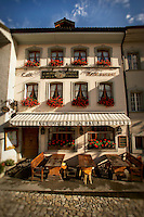 Decorative Facade of Cafe Auberge de la Halle in Gruyeres, Switzerland