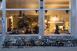 Evening view of The Barn, a gourmet bohemian coffee shop in Prenzlauer Berg , in Berlin, Germany