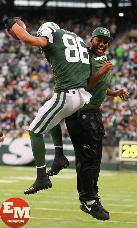 Dec 22, 2013; East Rutherford, NJ, USA; New York Jets wide receiver David Nelson (86) celebrates his touchdown during the first half of their game against the Cleveland Browns at MetLife Stadium.