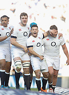 Danny Care of England (C) celebrates after scoring their first try during the RBS 6 Nations match at Twickenham Stadium, Twickenham<br /> Picture by Andrew Tobin/Focus Images Ltd +44 7710 761829<br /> 09/03/2014