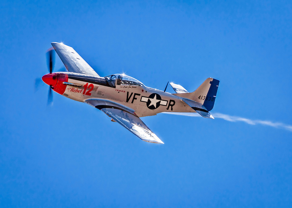 "P-51D Mustang, ""The Rebel 12"", flown by Doug Matthews of Wellington, Florida in the Unlimited Category, Silver Race, Sunday at Reno."