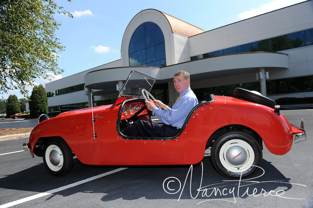 Shoe Show's founder and owner Robert Tucker in his 1949  Crosley, in front of the corporate headquarters