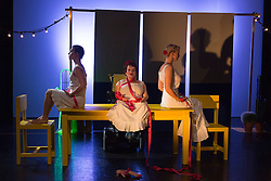 "© Licensed to London News Pictures. 05/10/2015. London, UK. L-R: Nicole Guarino, Caroline Bowditch and Welly O'Brien. Caroline Bowditch's ""Falling in Love with Frida"" explores the life, loves and legacy of disabled artist Frida Kahlo at the Lilian Baylis Studio/Sadler's Wells on 5-6 October 2015. Performed by Caroline Bowditch, Welly O'Brien, Nicole Guarino and Yvonne Strain (sign language interpreter). Photo credit: Bettina Strenske/LNP"