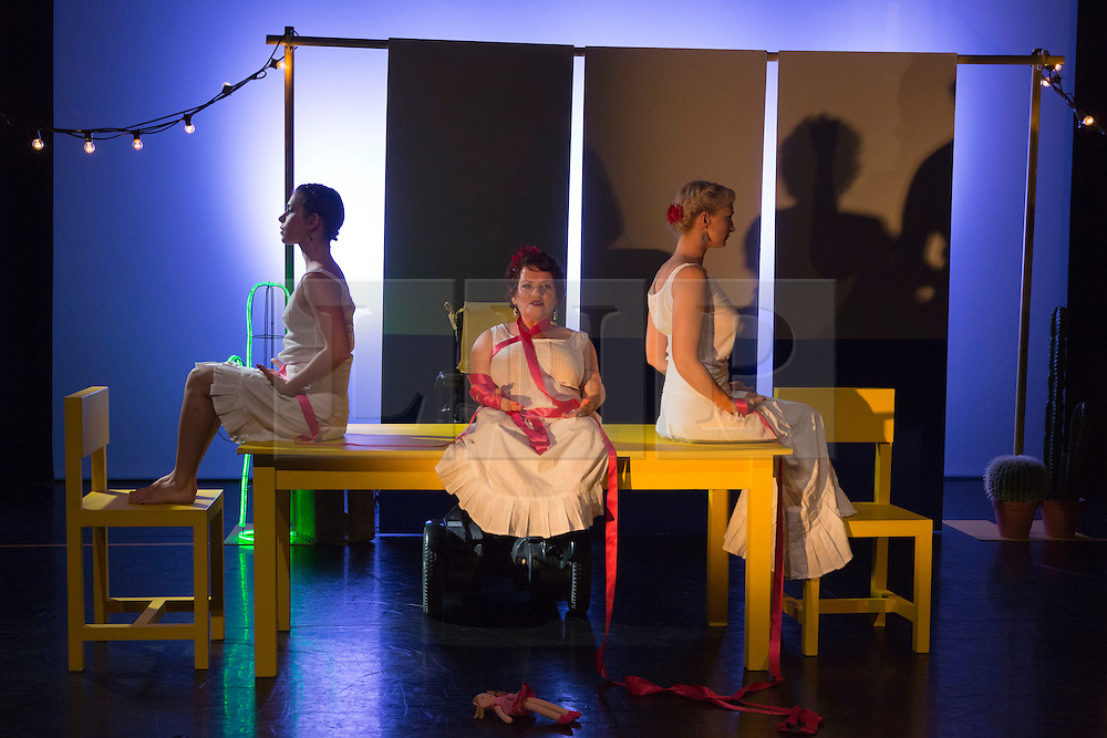 """© Licensed to London News Pictures. 05/10/2015. London, UK. L-R: Nicole Guarino, Caroline Bowditch and Welly O'Brien. Caroline Bowditch's """"Falling in Love with Frida"""" explores the life, loves and legacy of disabled artist Frida Kahlo at the Lilian Baylis Studio/Sadler's Wells on 5-6 October 2015. Performed by Caroline Bowditch, Welly O'Brien, Nicole Guarino and Yvonne Strain (sign language interpreter). Photo credit: Bettina Strenske/LNP"""