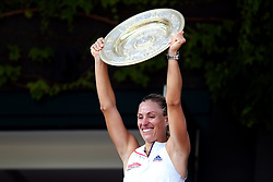 Angelique Kerber poses with the trophy on a centre court balcony on day twelve of the Wimbledon Championships at the All England Lawn Tennis and Croquet Club, Wimbledon.
