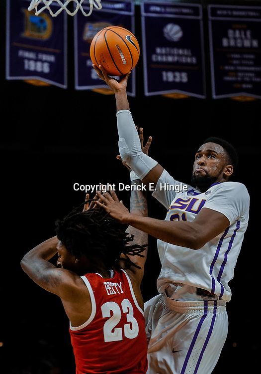 Jan 13, 2018; Baton Rouge, LA, USA; LSU Tigers forward Aaron Epps (21) shoots over Alabama Crimson Tide guard John Petty (23) during the second half at the Pete Maravich Assembly Center. Alabama defeated LSU 74-66.  Mandatory Credit: Derick E. Hingle-USA TODAY Sports