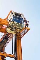 Limassol Cyprus Operator having a break on gantry of mobile crane