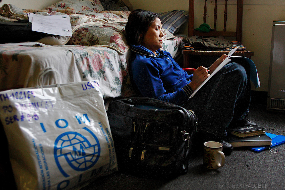 Drucie Bathin, 42, a case worker for the International Institute of Connecticut is a native Karen who is helping her people in their relocation in the United States. Bathin is shown here filling out paperwork for one of the refugee families.   .(Photo by Robert Falcetti)