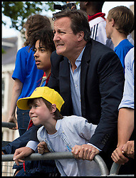 Image ©Licensed to i-Images Picture Agency. 05/07/2014. Yorkshire, United Kingdom.The Prime Minister David Cameron and his son Elwen react to Mark Cavendish crashing off his bike in the Tour de France finish line in Harrogate on stage one of the race after a fall  just  short of the finish line . Picture by Andrew Parsons / i-images