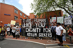 © Licensed to London News Pictures. 30/06/2012. Bristol, UK. Asylum Seekers and supporters at Trinity Road police station, during a march through Bristol, calling for dignity and justice for asylum seekers in the UK.  Trinity Road police station is often where asylum seekers in Bristol have to sign on. The English Defence League are due to march in Bristol in 2 weeks time on 14 July.  30 June 2012..Photo credit : Simon Chapman/LNP