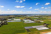Nederland, Zuid-Holland, Gemeente Zuidplas, 15-07-2012; kassen ten oosten van Zevenhuizen in de Zuidplaspolder. De polder is een droogmakerij, de plas was om zijn beurt ontstaan door afgraven van veen voor het winnen van turf. Het nu nog overwegend landelijk gebied hoorde oorspronkelijk bij het Groene Hart, maar toekomstplannen voorzien in het verder bebouwen van de polder (vanuit de omliggende steden). .Greenhouses in the polder in the Green Heart of the Netherlands. Polder is a drained lake polder..luchtfoto (toeslag), aerial photo (additional fee required).foto/photo Siebe Swart