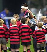 Photo Peter Spurrier<br /> 17/11/2002<br /> Zurich Premiership Rugby - Harlequins v Wasps<br /> Andre Vos leads the team out for the first time. [Mandatory Credit:Peter SPURRIER/Intersport Images]