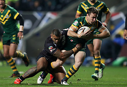 Australia's James Maloney is tackled by New Zealand's Manu Ma'u during the Four Nations match at the Ricoh Arena, Coventry.