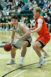 BLOOMINGTON, IL - December 15: Matthew Leritzand Tyler Ingebrigtsen during a college basketball game between the IWU Titans  and the Carroll Pioneers on December 15 2018 at Shirk Center in Bloomington, IL. (Photo by Alan Look)