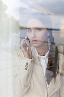 Portrait of confident businesswoman using cell phone in office