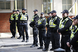 © Licensed to London News Pictures. 09/10/2019. London, UK. Police officers from the Hampshire Constabulary stand outside The Home Office as Extinction Rebellion activists take part in a third day of protests in central London. The climate change group intend to blockade the Westminster area for two weeks to demand that the government takes immediate and decisive action on climate change. Photo credit: Peter Macdiarmid/LNP