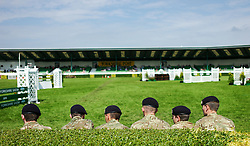 © Licensed to London News Pictures.16/07/15<br /> Harrogate, UK. <br /> <br /> Soldiers sit on a bench in the main show jumping arena on the final day of the Great Yorkshire Show.  <br /> <br /> England's premier agricultural show has seen three days of showcasing the best in British farming and celebrating the countryside.<br /> <br /> The event which attracts over 130,000 visitors each year displays the cream of the country's livestock and offers numerous displays and events giving the chance for visitors to see many different countryside activities.<br /> <br /> Photo credit : Ian Forsyth/LNP