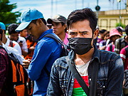 05 JULY 2017 - POIPET, CAMBODIA: Cambodian migrant workers going to Thailand line up for their paperwork near the border crossing in Poipet. The Thai government proposed new rules for foreign workers recently. The new rules include fines of between 400,000 and 800,00 Thai Baht ($12,000 - $24,000 US) and jail sentences of up to five years for illegal workers and people who hire illegal workers. Hundreds of companies fired their Cambodian and Burmese workers and tens of thousands of workers left Thailand to return to their countries of origin. Employers and human rights activists complained about the severity of the punishment and sudden implementation of the rules. On Tuesday, 4 July, the Thai government suspended the new rules for 180 days and the Cambodian and Myanmar governments urged their citizens to stay in Thailand, but the exodus of workers continued through Wednesday.     PHOTO BY JACK KURTZ