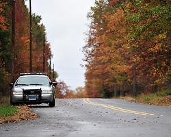A Connecticut State Trooper guards a section of Paradise Township. Police and federal agents continue to comb the Pocono Mountains in search of alleged cop killer Eric Matthew Frein Oct. 22, 2014, near Henryville, Pa. (Chris Post | lehighvalleylive.com)